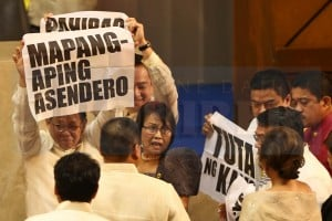<span>Makabayan congressmen boo Pres. Benigno S. Aquino III after his speech in his last State of the Nation Address inside the Congress' Plenary Hall. </span>