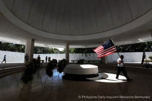 <span>A man carries a US flag inside the US War Pacific Memorial in Corregidor Island during the 45th Commemoration of the Fall of Corregidor, May 6, 2017. The memorial was built in remembrance of the American and Filipino soldiers who fought on World War II.</span>